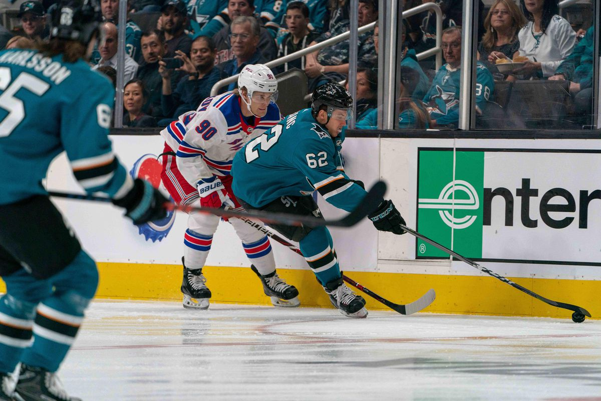 Oct 30, 2018; San Jose, CA, USA; San Jose Sharks right wing Kevin Labanc (62) and New York Rangers center Vladislav Namestnikov (90) fight for the puck during the first period at SAP Center at San Jose.