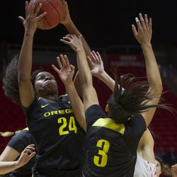 Oregon Ducks forward Ruthy Hebard (24) and guard Justine Hall (3) grab for a rebound during the Utes' 84-68 loss to the Oregon Ducks at the Jon M. Huntsman Center in Salt Lake City on Sunday, Jan. 28, 2018.