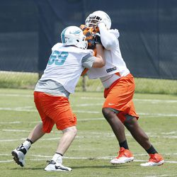 DAVIE, FL - MAY 23: Ja'Wuan James #72 and David Hurd #69 of the Miami Dolphins participate in drills during the rookie minicamp on May 23, 2014 at the Miami Dolphins training facility in Davie, Florida.
