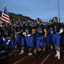 Lincoln-Way East's captains lead the team. Allen Cunningham/For the Sun-Times.