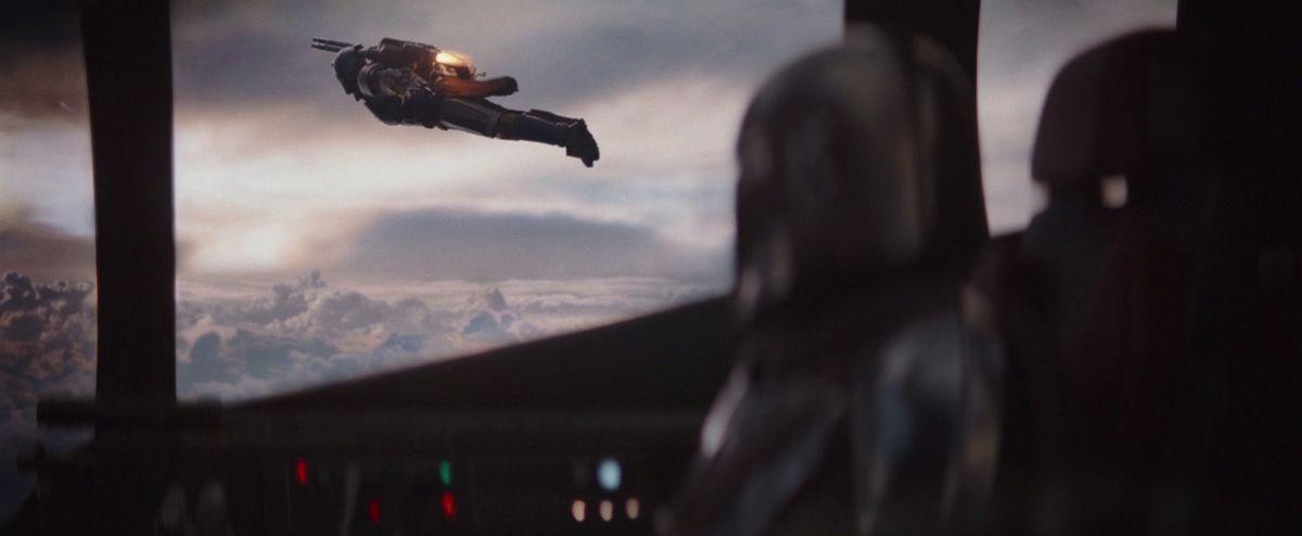 A fellow Mandalorian shows off his jetpack