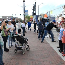 2:13 p.m. Others waiting to have their photo taken in front of the marquee -