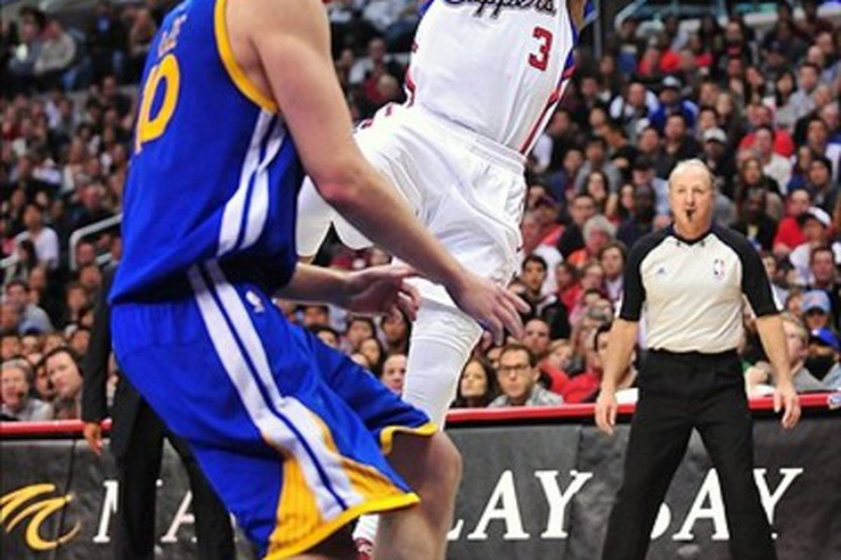 March 11, 2012; Los Angeles, CA, USA; Los Angeles Clippers point guard Chris Paul (3) shoots a basket against the Golden State Warriors during the second half at Staples Center. Mandatory Credit: Gary A. Vasquez-US PRESSWIRE