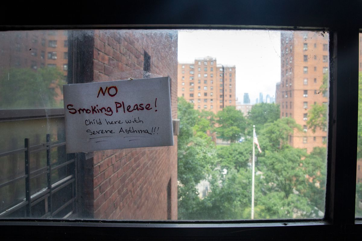 A note in a Wald Houses building touches upon health concerns of residents, Aug. 19, 2020.