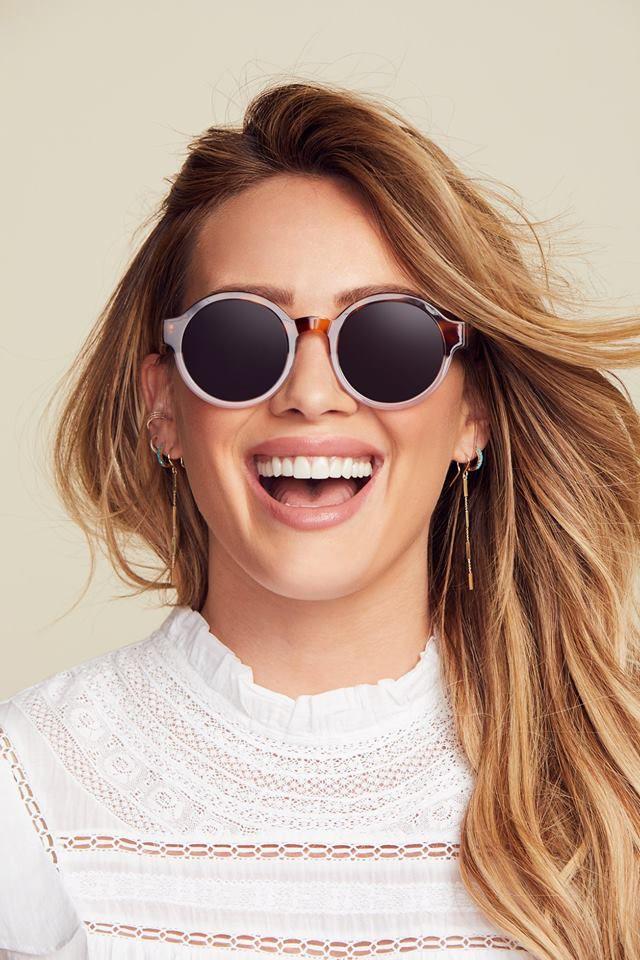 Hillary Duff wearing sunglasses