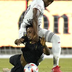 Real Salt Lake midfielder Anderson Julio, top, and Los Angeles FC forward Latif Blessing battle for the ball during the second half of a Major League Soccer match Saturday, July 17, 2021, in Los Angeles. LAFC won 2-1.