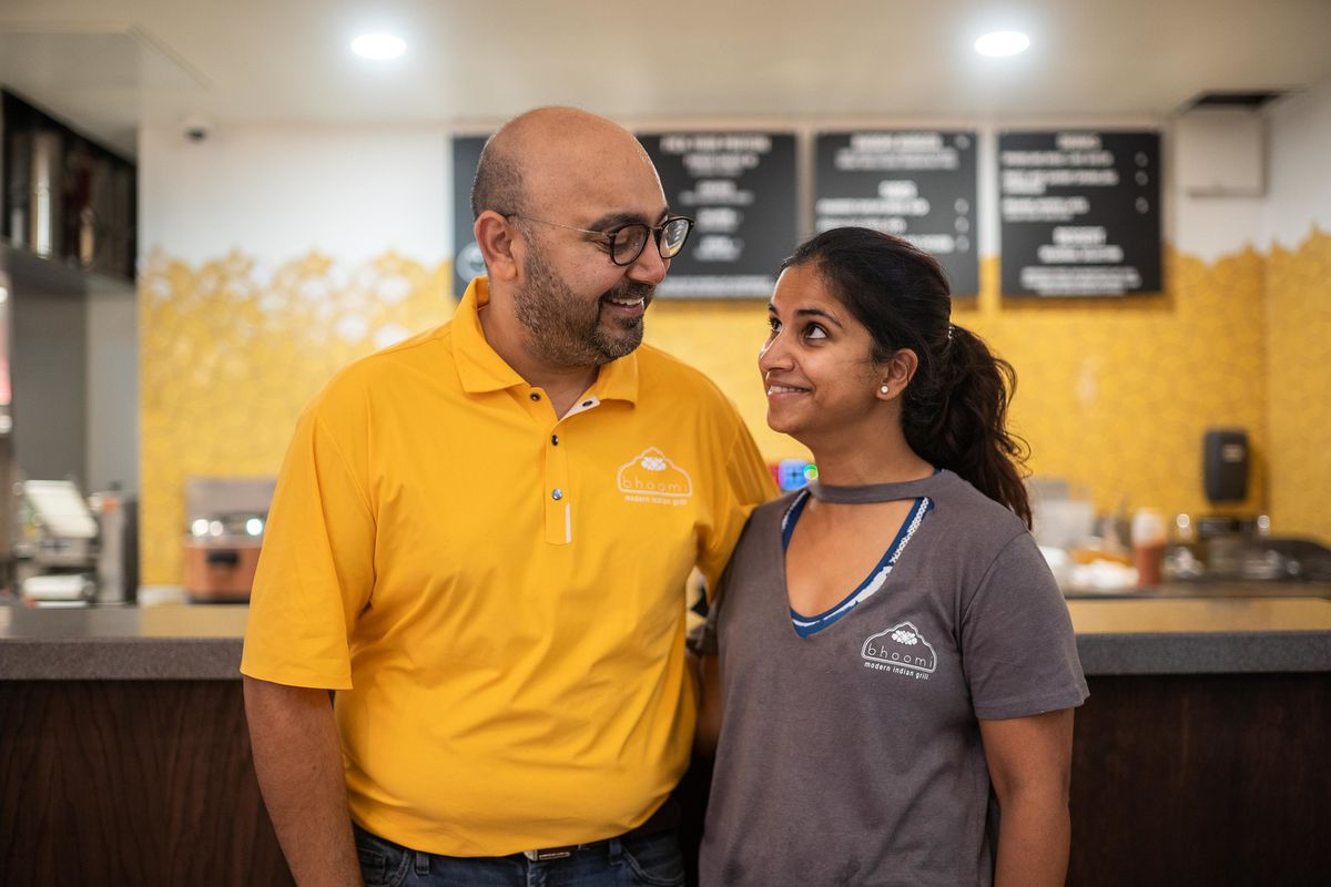 Bhoomi co-owners Ajit and Such Kalra pose for a picture in their new location at Urban Space, located at 15 W. Washington St. in the Loop, Saturday afternoon, Sept. 18, 2021.