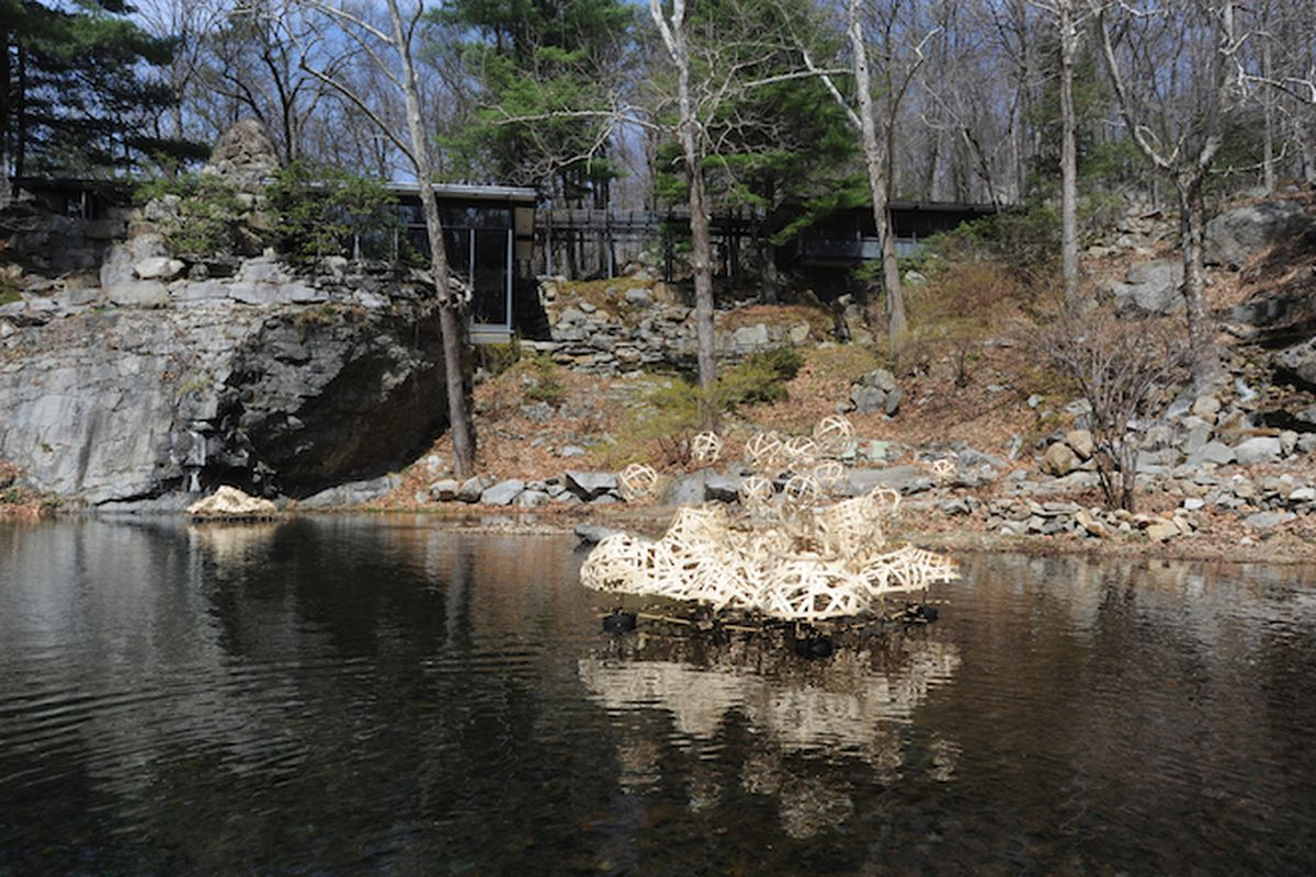 The home and quarry pool at Manitoga, Russel Wright's residence in Garrison, New York. As part of the home's artist in residency program, Stephen Talasnik built a series of floating reed structures on view this season. All images provided by Manitog