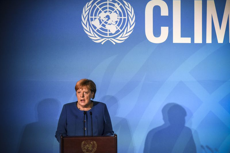 German Chancellor Angela Merkel onstage speaking from the podium at the UN Climate Summit.