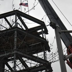 The American flag atop the jumbotron structure -