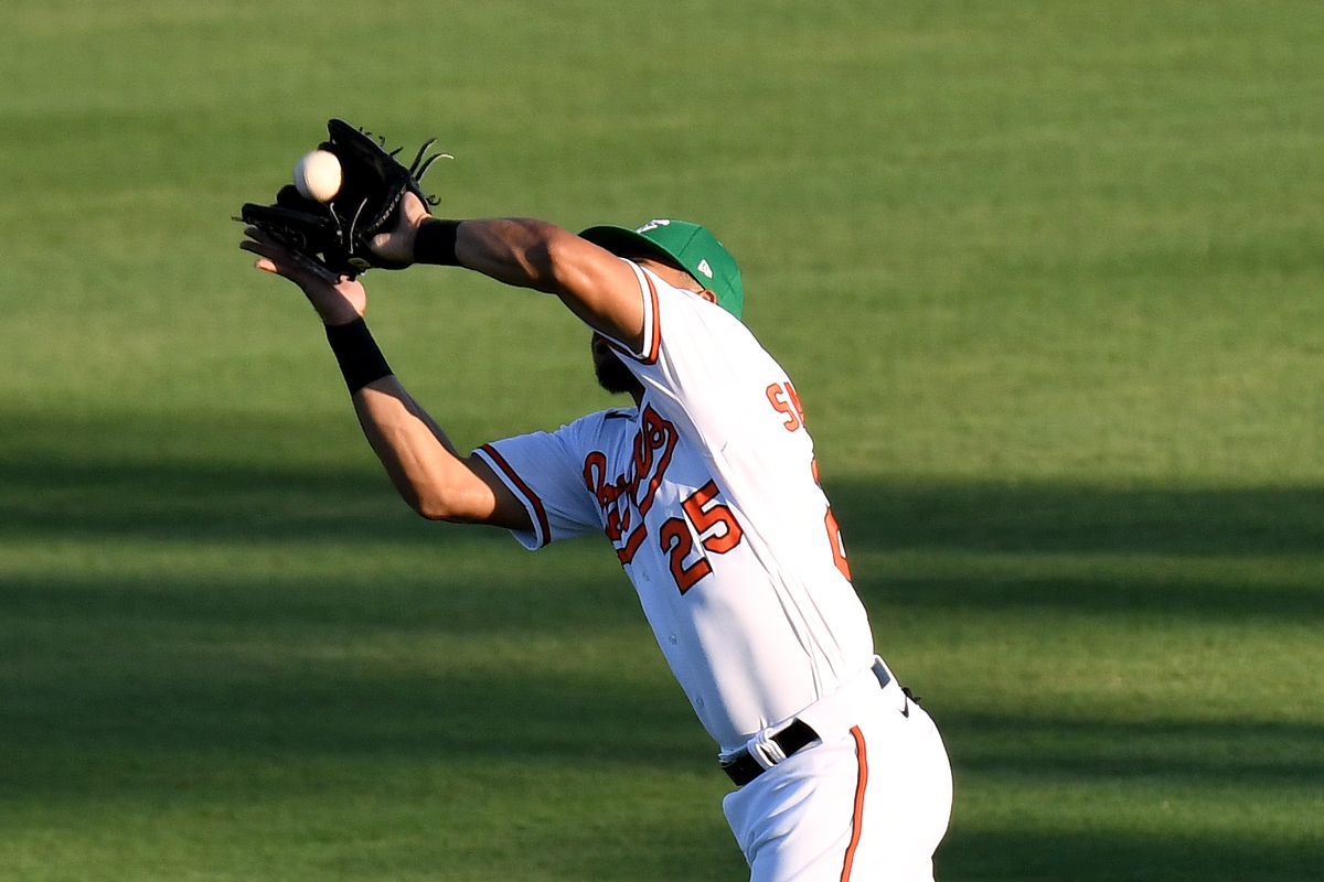 Baltimore Orioles outfielder Anthony Santander catches a fly ball against the Atlanta Braves in the third inning during a spring training game at Ed Smith Stadium.