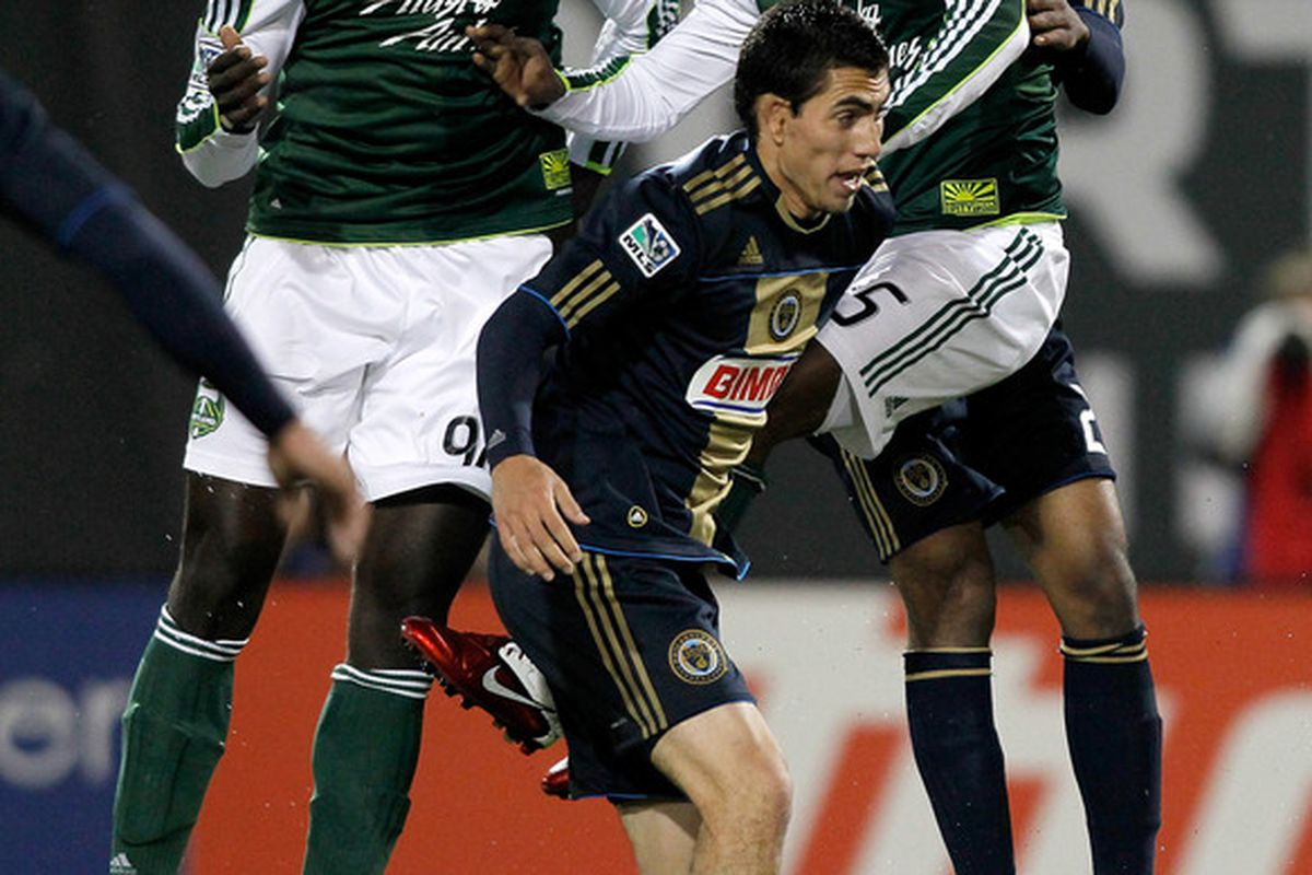 PORTLAND, OR - MAY 06:  Mamadou Danso #98 of the Portland Timbers heads the ball for a goal against Michael Farfan #21 of the Philadelphia Union  on May 6, 2011 at Jeld-Wen Field in Portland, Oregon.  (Photo by Jonathan Ferrey/Getty Images)