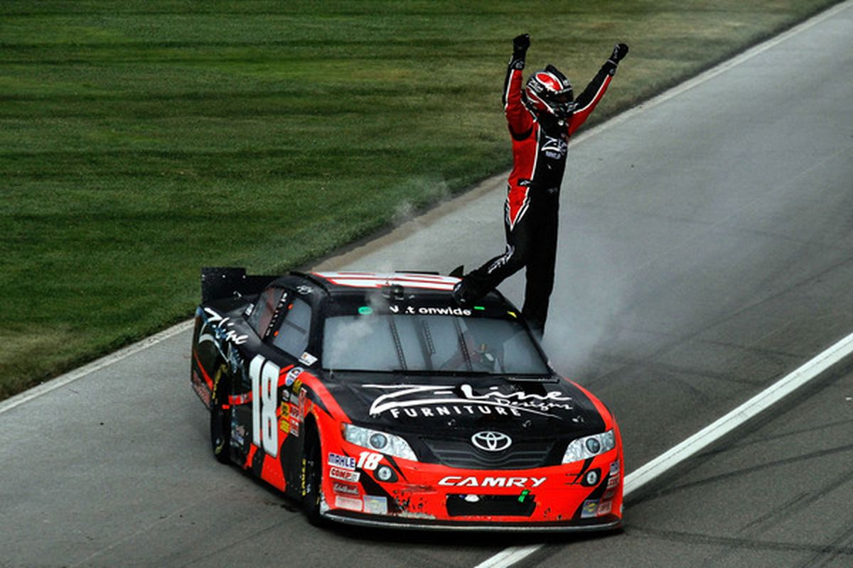 Kyle Busch celebrates after winning the NASCAR Nationwide Series Royal Purple 300 at Auto Club Speedway.