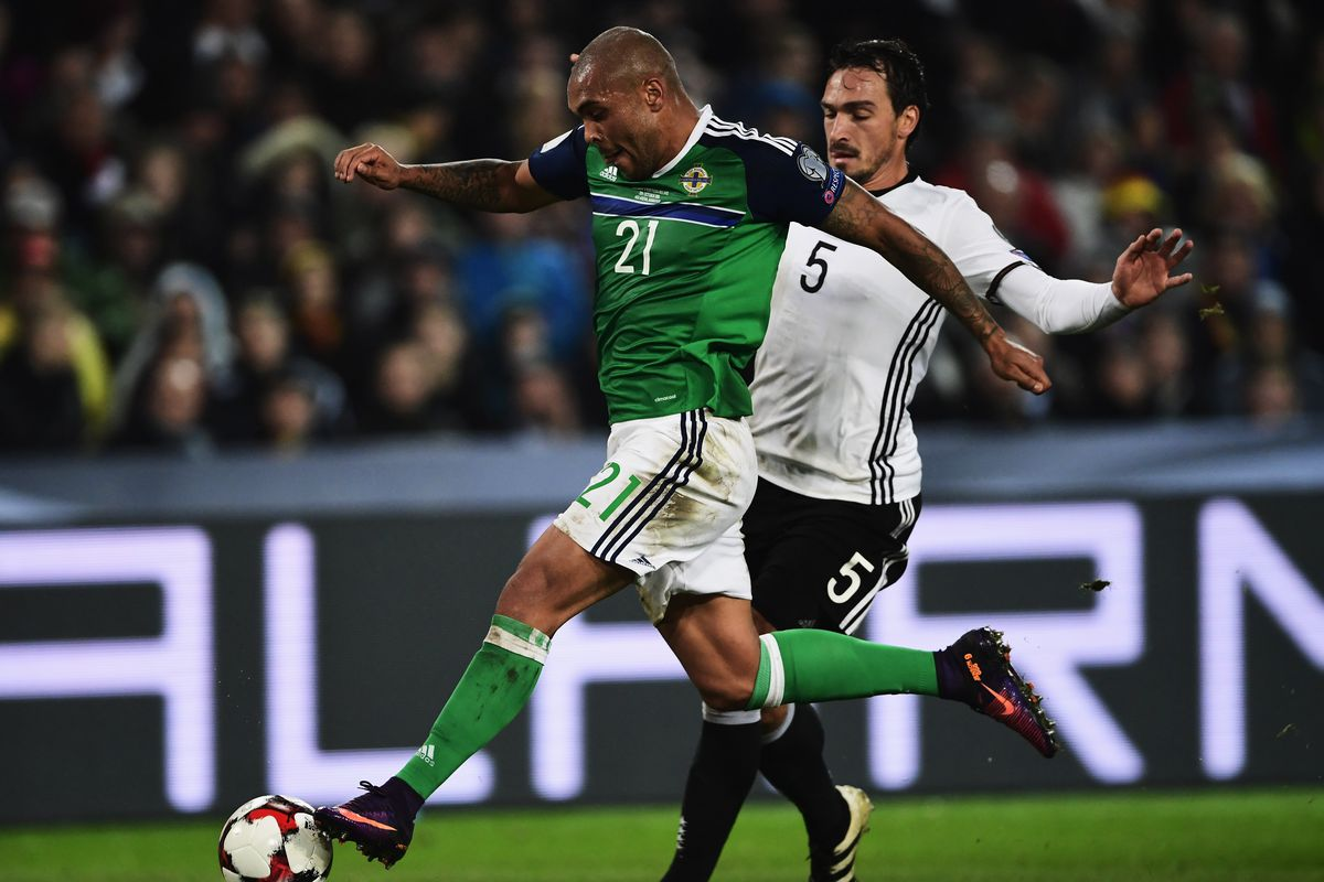 Battling Northern Ireland beaten by holders Germany