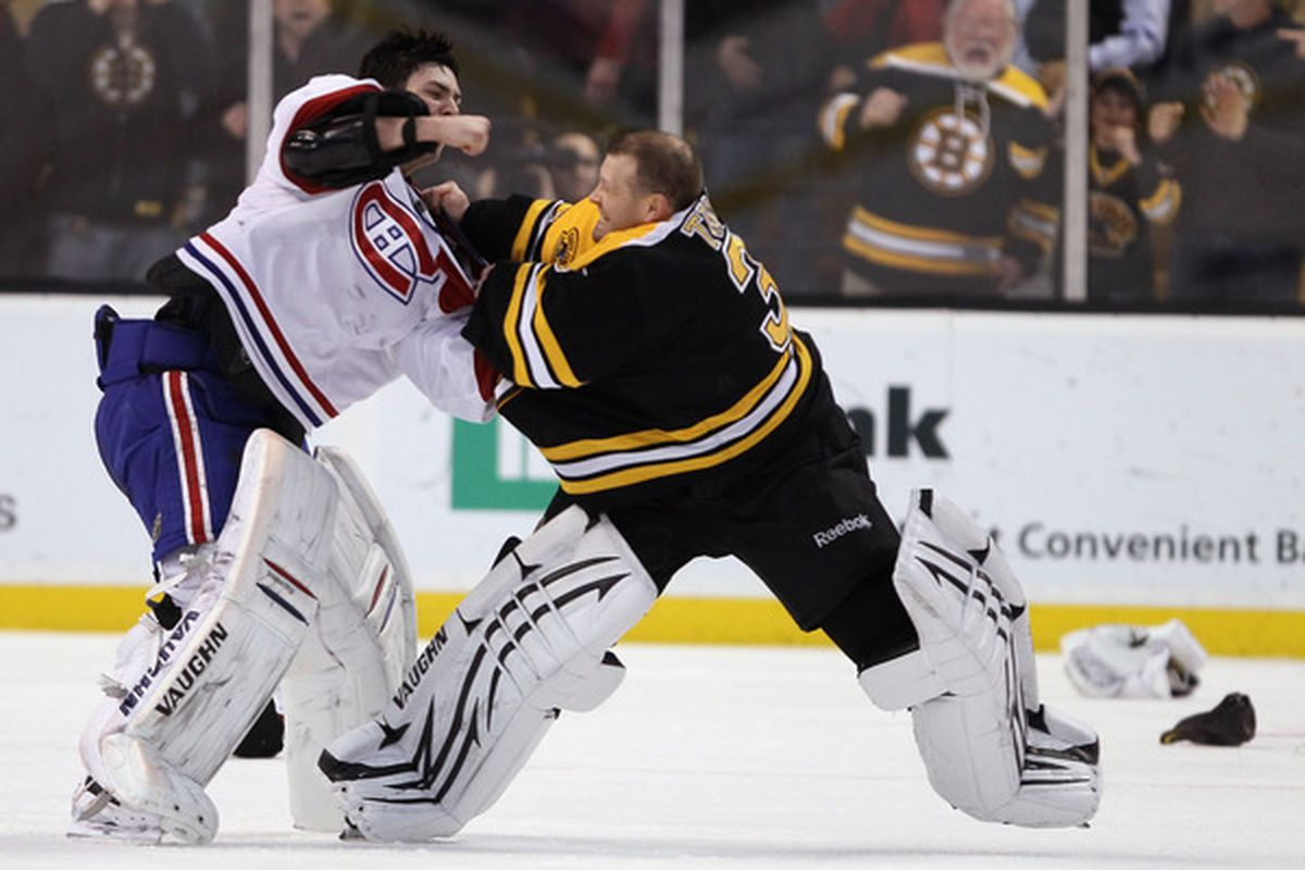 BOSTON MA - FEBRUARY 09:  Tim Thomas #30 of the Boston Bruins and Carey Price #31 of the Montreal Canadiens fight in the second period on February 9 2011 at the TD Garden in Boston Massachusetts.  (Photo by Elsa/Getty Images)
