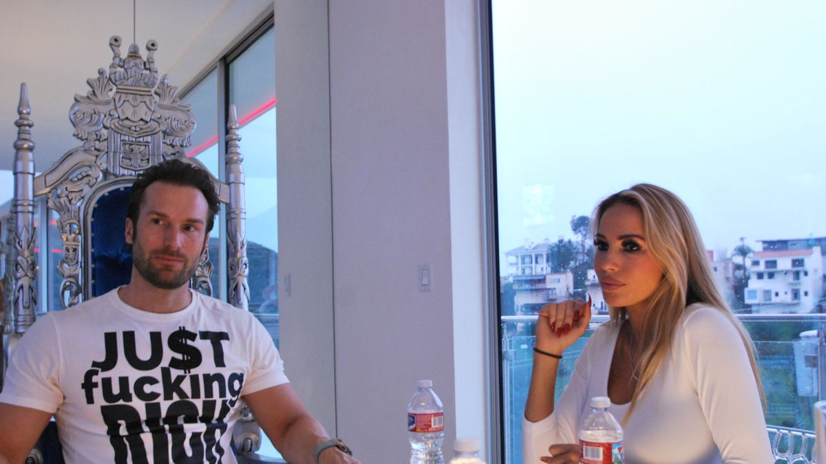 Bastian Yotta sits on a throne at his dining table, next to his wife Maria.