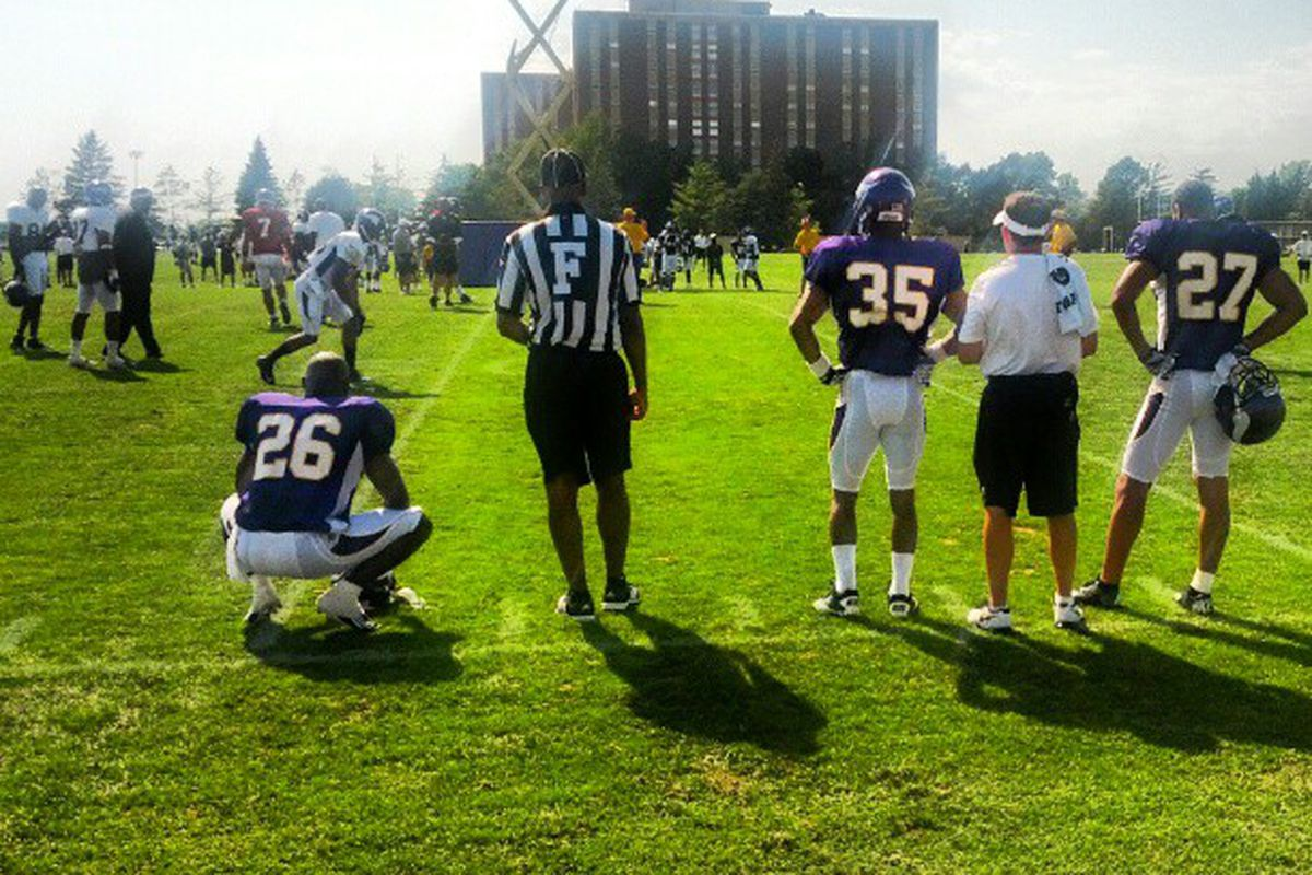 Antoine Winfield, Marcus Sherels, and Brandon Burton look on as wide receivers and secondary players run 1-on-1 drills Wednesday afternoon in Mankato.