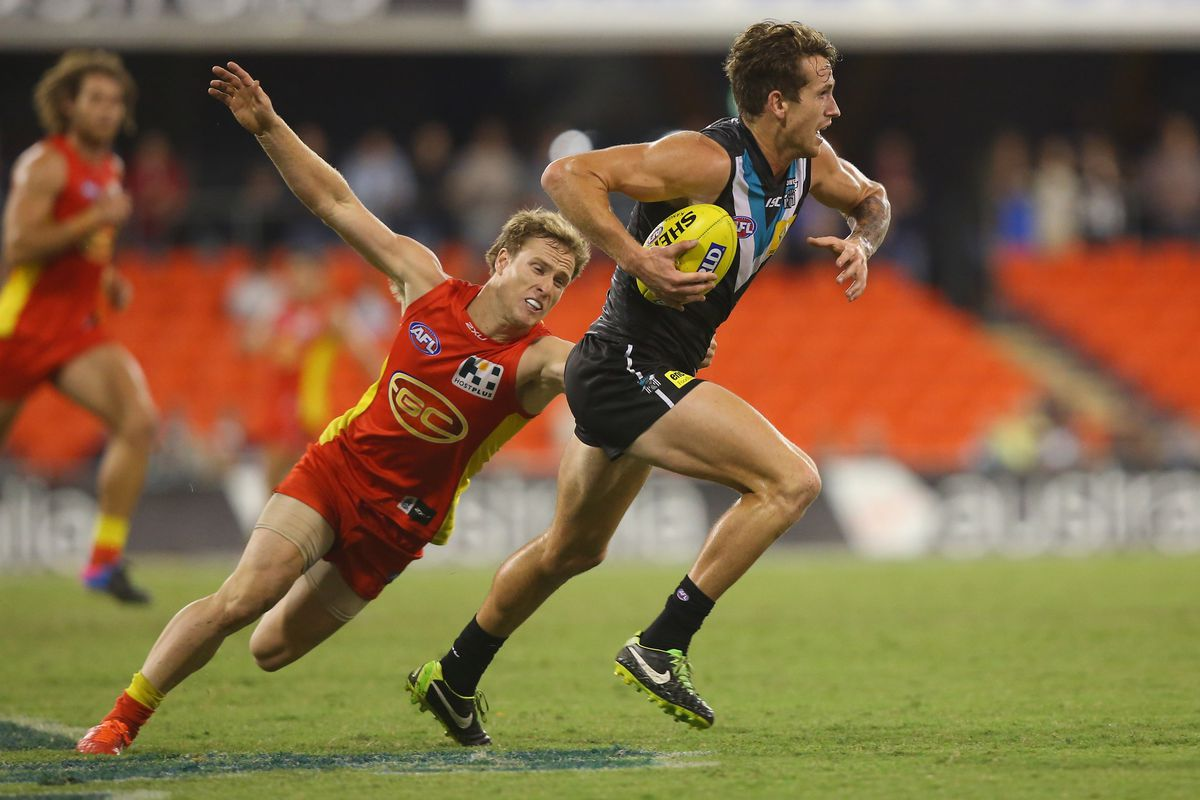 The guy running the ball is named Cameron O'Shea and he plays Aussie Rules Football.