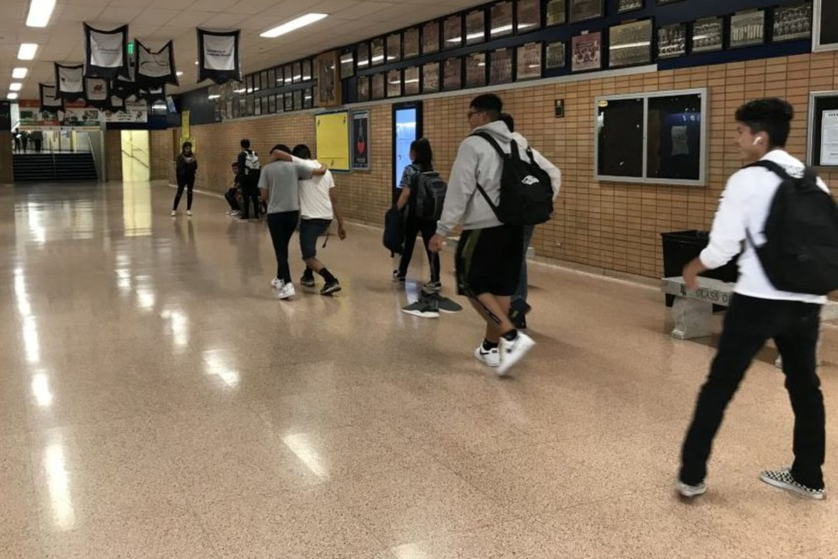 Students walk down the hallway at Denver's Abraham Lincoln High School in August 2019.
