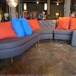 large purple reupholstered 50's sectional sofa: $3500