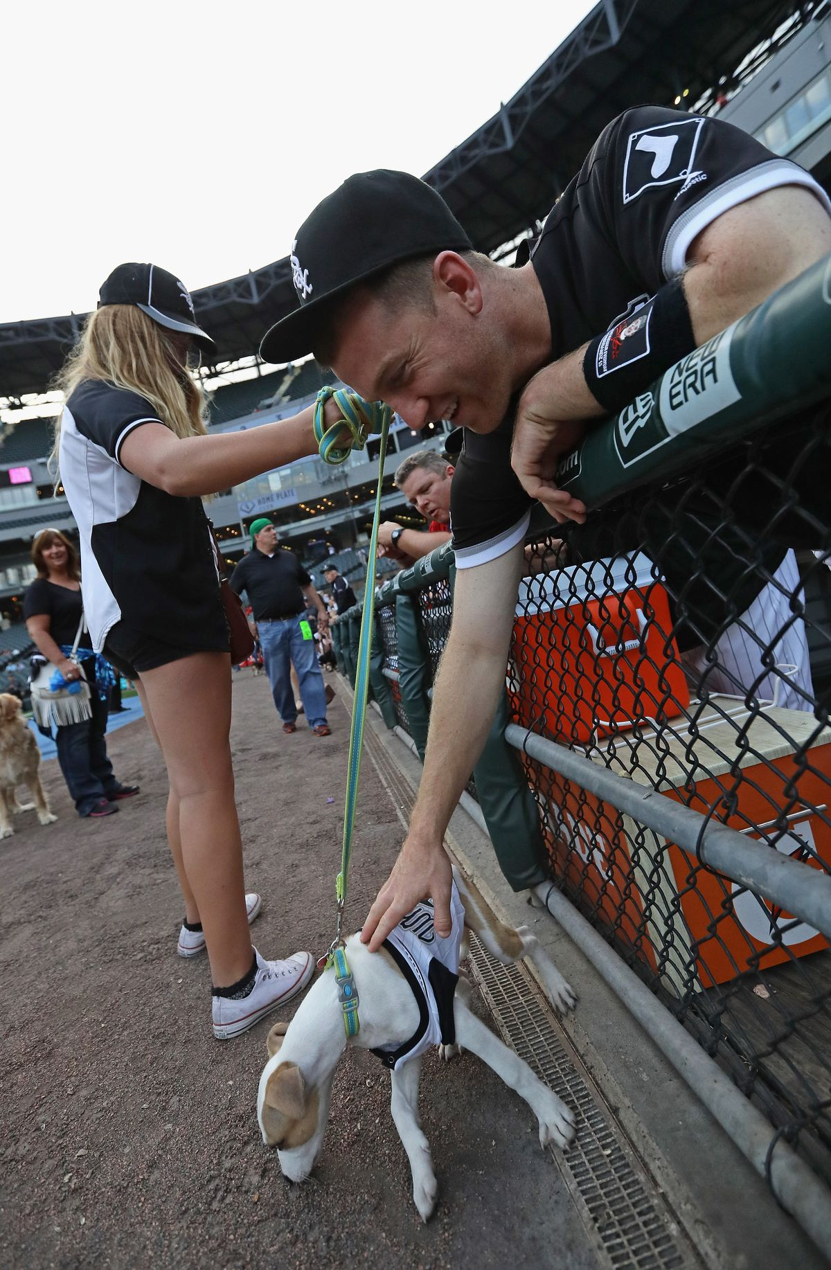 Todd Frazier pets a puppy. (Photos by Jonathan Daniel/Getty Images)
