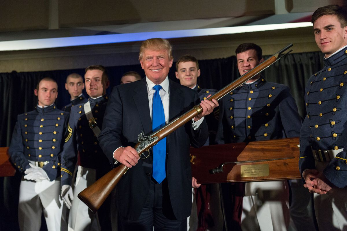 Donald Trump holds up a replica flintlock rifle awarded him by cadets during the Republican Society Patriot Dinner at the Citadel Military College on February 22, 2015 in Charleston, South Carolina.