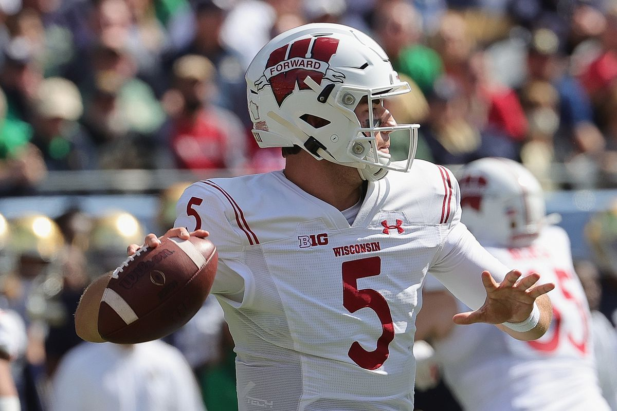 Graham Mertz of the Wisconsin Badgers passes against the Notre Dame Fighting Irish at Soldier Field on September 25, 2021 in Chicago, Illinois.