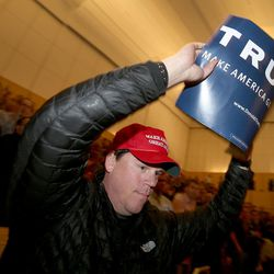 A Donald Trump supporter exits the auditorium after listening to Mitt Romney address the Hinckley Institute of Politics on the state of the 2016 presidential race at the University of Utah in Salt Lake City on Thursday, March 3,  2016.
