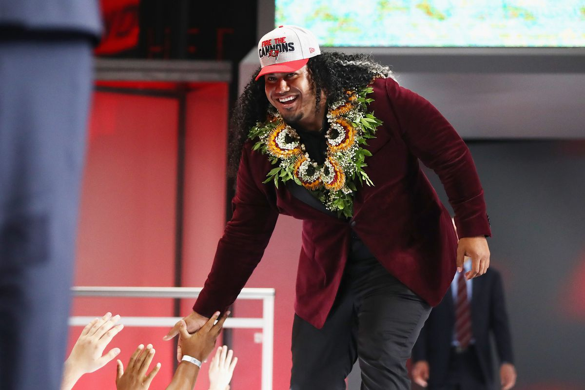 ARLINGTON, TX - APRIL 26:  Vita Vea of Washington high fives fans after  being picked #12 overall by the Tampa Bay Buccaneers during the first  round of the 2018 NFL Draft at AT&T Stadium.