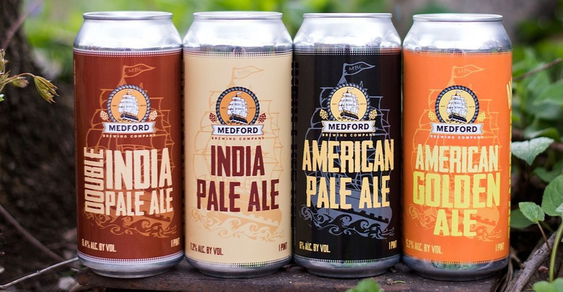 Four different beer cans from the same brewery are lined up: a double IPA, an IPA, an American pale ale, and a golden ale.