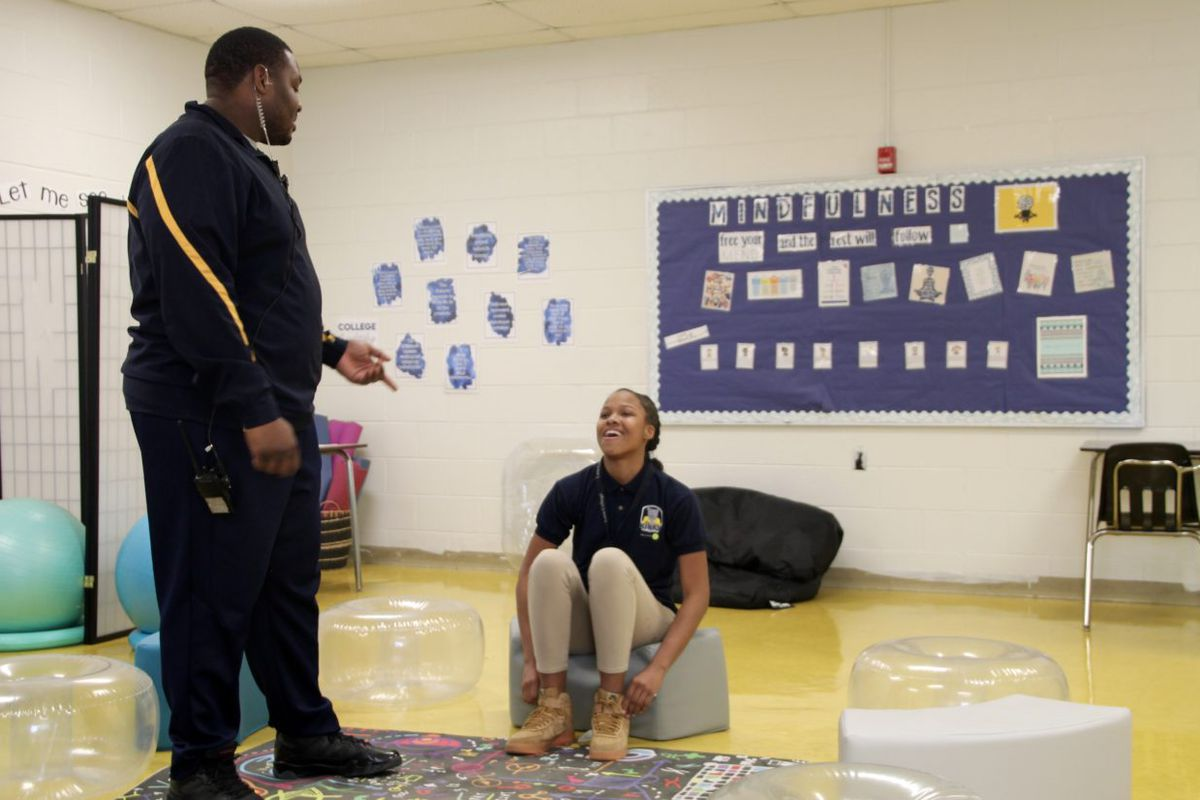 At Kirby Middle School, Rolander Mann (left) went from managing in-school-suspension to staffing the reflection room, a restorative justice effort.