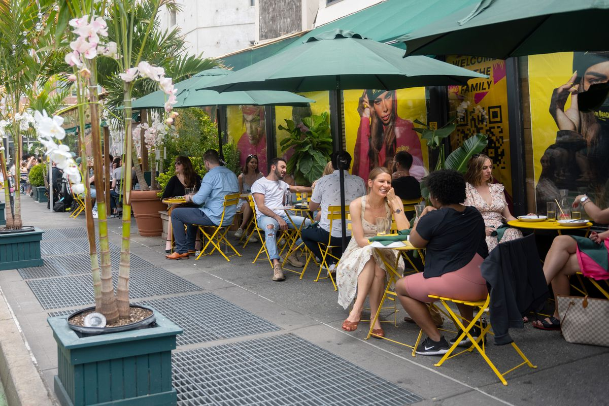 Customers have brunch at non-socially- distanced tables at Baby Brasa's outdoor dining on May 22, 2021 in New York City.