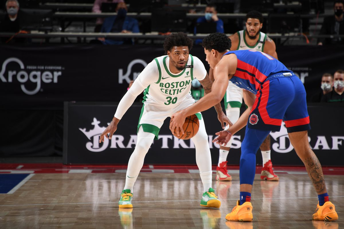 Marcus Smart of the Boston Celtics plays defense during the game against the Detroit Pistons on January 3, 2021 at Little Caesars Arena in Detroit, Michigan.