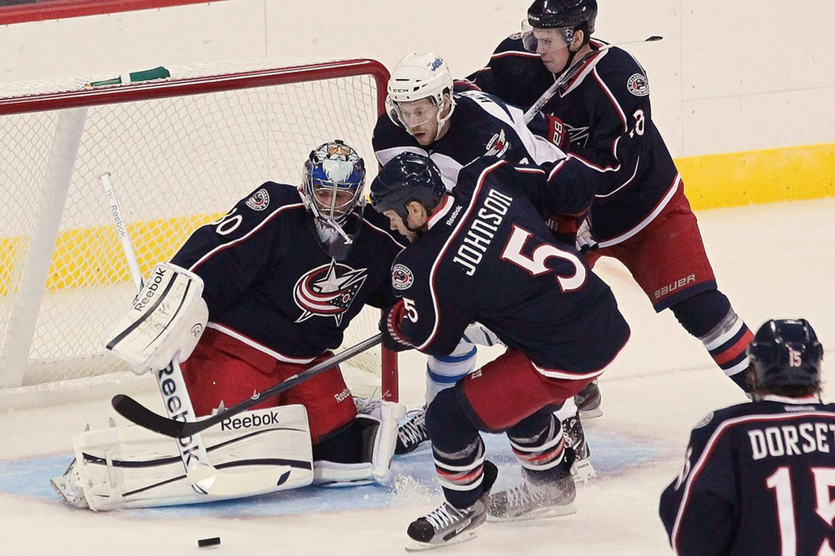 Curtis Sanford, stopping pucks in Union Blue. Will Jackets fans get used to this sight?  (Photo by Marianne Helm/Getty Images)