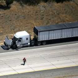 A piece of the plane is on the ground, in front of a truck, after a plane crashed on I-15, killing all four people on board, Riverdale on Wednesday, July 26, 2017. All four people on board died.