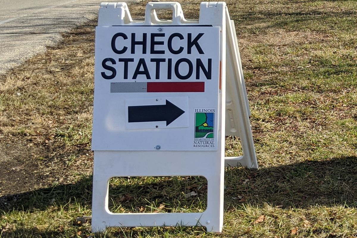 File photo of a sign for a deer check station. Credit: Dale Bowman