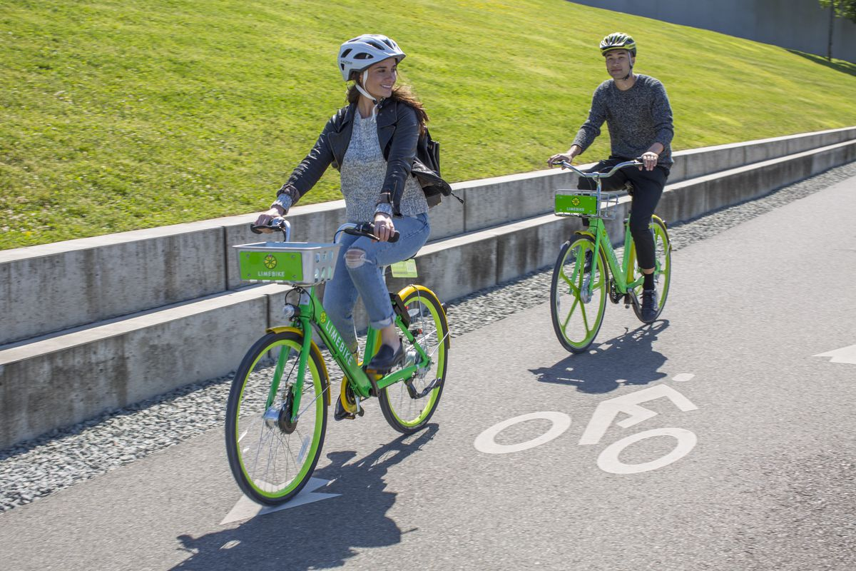LimeBike users ride bicycles in Seattle