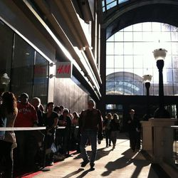 Shoppers line up outside the new H & M store at City Creek during the mall's grand opening Thursday,  March 22, 2012.