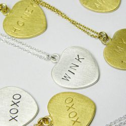 """Wear your heart around your neck with these stamped sweet and sassy phrases from <strong>Hannah Blount</strong>, <a href=""""http://www.hannahblount.com/products/conversation-heart-necklace#"""">$76</a>"""