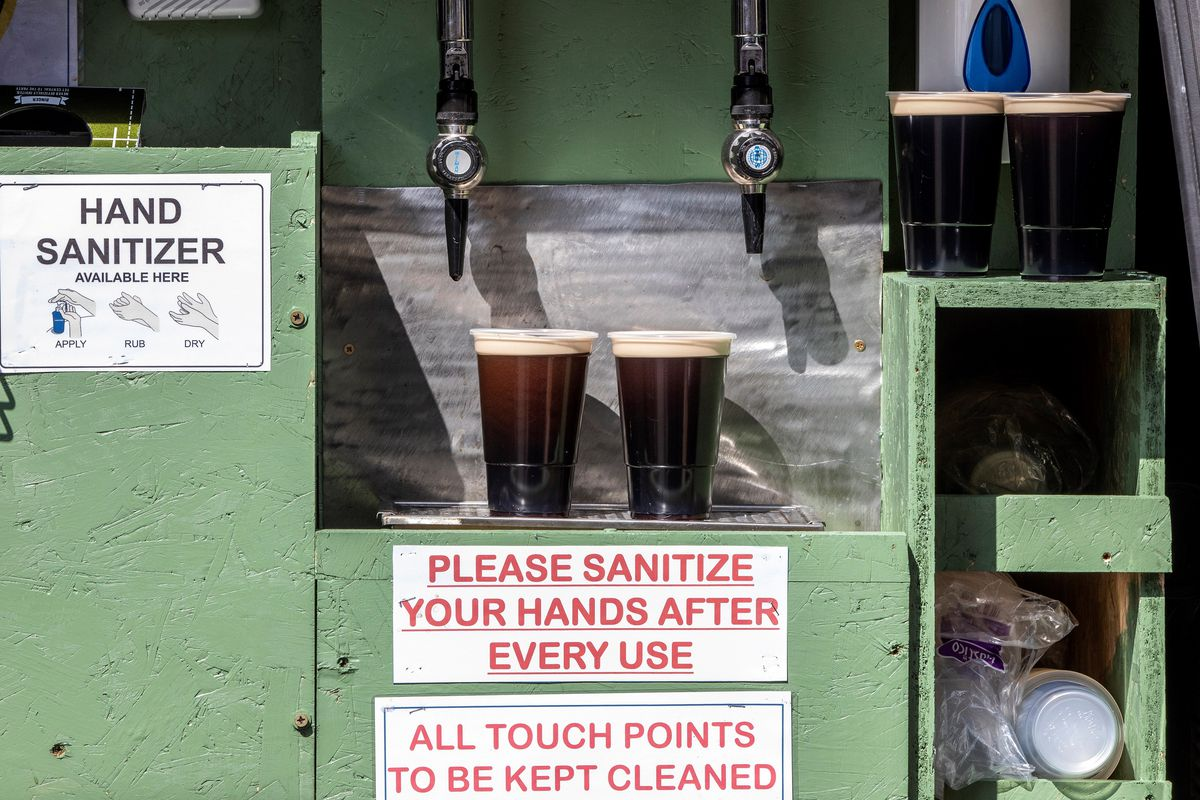 Pints of freshly poured Guinness, poured from the back of The Hatfield House bar's converted delivery van, settle before being delivered to a customers' front door, in Belfast, Northern Ireland, on April 16, 2020.