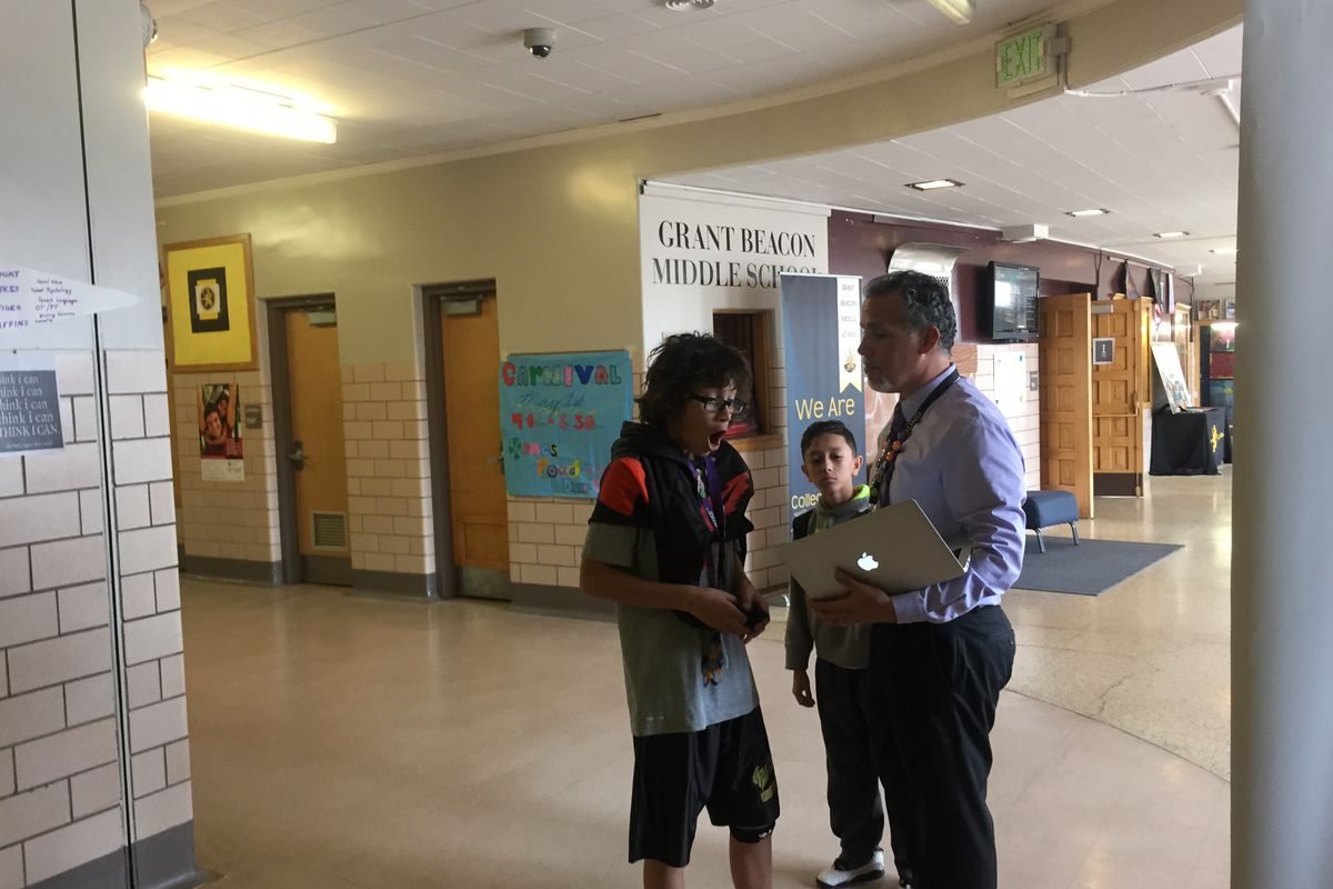 Alex Magaña, then principal at Grant Beacon Middle School, greeted students as they moved between classes in 2015.