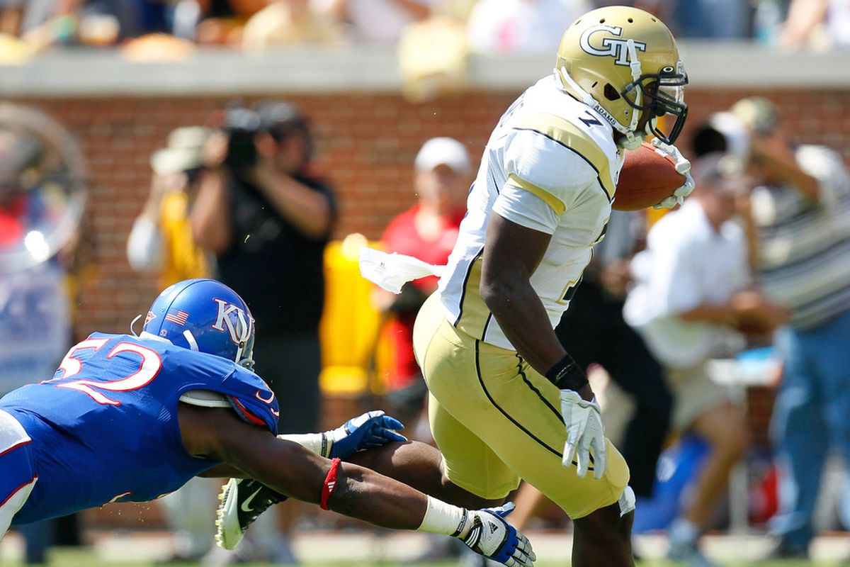 ATLANTA, GA - SEPTEMBER 17:  David Sims #7 of the Georgia Tech Yellow Jackets scores a touchdown against Steven Johnson #52 of the Kansas Jayhawks at Bobby Dodd Stadium on September 17, 2011 in Atlanta, Georgia.  (Photo by Kevin C. Cox/Getty Images)
