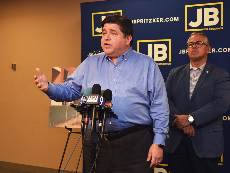 J.B. Pritzker calls out Gov. Bruce Rauner's administration at a press conference on Thursday, Oct. 4. He was with Ald. Gilbert Villegas.   Emily McTavish/ Sun-Times
