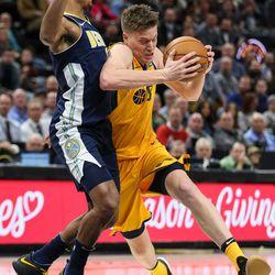 Utah Jazz forward Jonas Jerebko (8) drives against Denver Nuggets guard Gary Harris (14) at Vivint Smart Home Arena in Salt Lake City on Tuesday, Nov. 28, 2017.