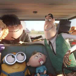 """Bob (center) hitches a ride to Villain-Con from the Nelson family — (left to right) Madge (Allison Janney), Walter Jr. (Michael Beattie), Binky, Walter (Michael Keaton) and Tina (Katy Mixon) —in """"Minions."""""""