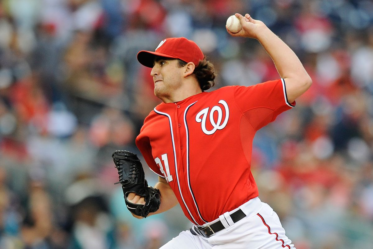 WASHINGTON, DC - JULY 21:  John Lannan #31 of the Washington Nationals throws a pitch against the Atlanta Braves during a game at Nationals Park on July 21, 2012 in Washington, DC.  (Photo by Patrick McDermott/Getty Images)