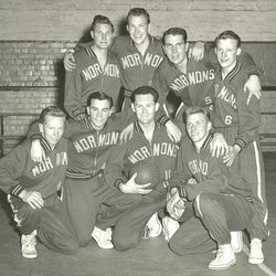 Mormon Yankees in Adelaide, Australia, in 1954. The 1954 team was coached by Elder Loren C. Dunn. The team won the Adelaide city league championship and the South Australian state title. Back row (left to right): Arthur Emery (local member), Elder Edward E.(Ted) Johnson, Elder Norman L. Weitzeil, Elder Arnold A. Thayer. Front row: Elder Theodore E. (Ted) Haynes, Elder Robert E. Steck, Elder Loren C. Dunn, Elder R. Halbert Christensen.