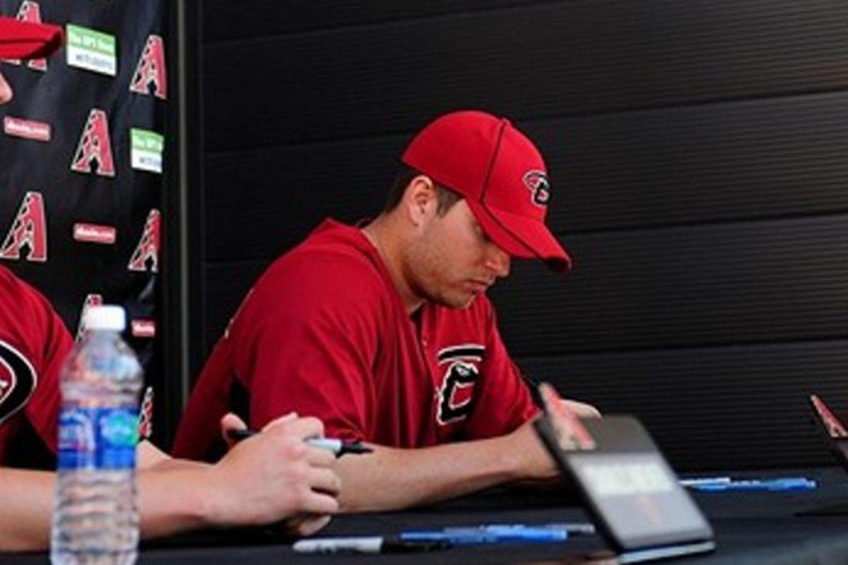 Evan Marshall signing autographs.