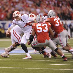 Joel Stave is dragged down by Ohio State defenders