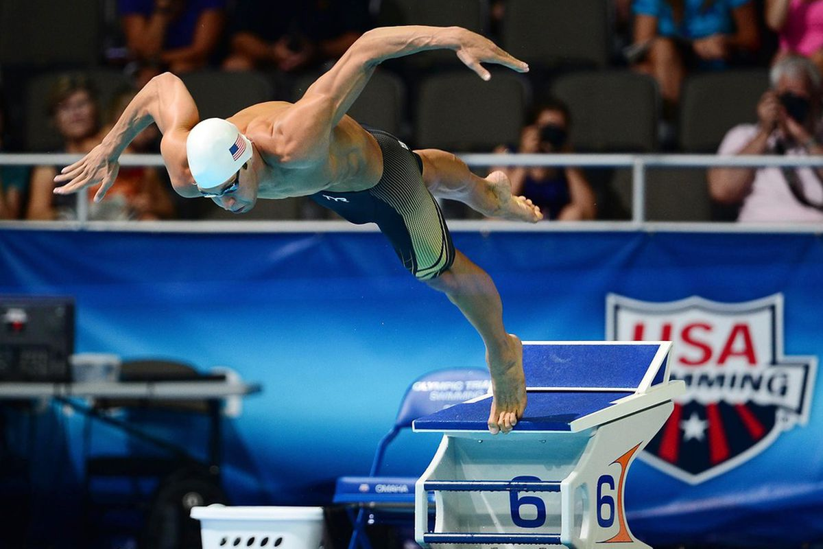 June 30, 2012; Omaha, NE, USA; Matt Grevers jumps off the starting block to start the mens 50m freestyle preliminary in the 2012 U.S. Olympic swimming team trials at the CenturyLink Center. Mandatory Credit: Andrew Weber-US PRESSWIRE